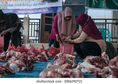 Sumbawa, Indonesia - 31 July 2020 : The process of cutting Qurban meat in the Eid Al-Adha ritual by Indonesian Muslims Islam