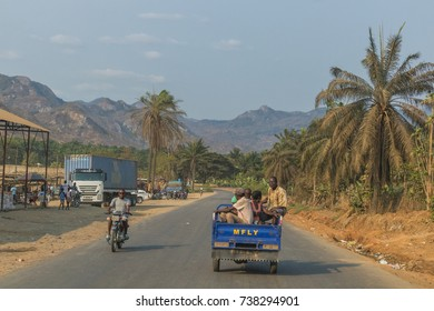 SUMBE/ANGOLA 10 OCT 2017 African family travel by motorcycle. Angola.