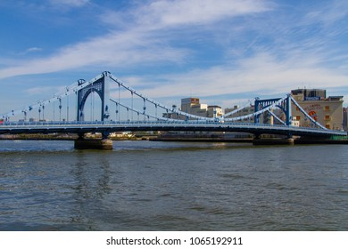 SUMIDA RIVER, TOKYO, JAPAN - MARCH 3RD, 2018. The historic steel Kiyosumi Bridge spans the Sumida River in Tokyo. It was completed in March 1928.