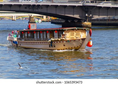 SUMIDA RIVER, TOKYO, JAPAN - MARCH 3RD, 2018. A traditional 'Yakatabune' eating, drinking and sightseeing boat on the Sumida River in Tokyo.