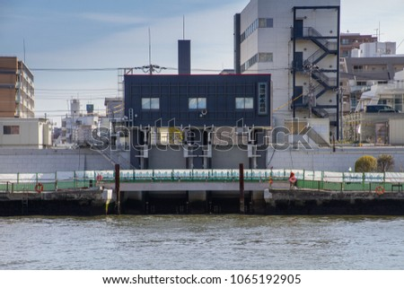 SUMIDA RIVER, TOKYO, JAPAN - MARCH 3RD, 2018. Recently reconstructed flood control gates on the Sumida River. These gates protect the low level east side of Tokyo.