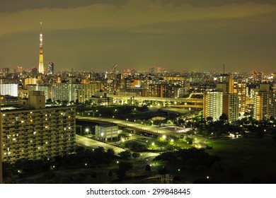 SUMIDA, TOKYO - AUGUST 22, 2014: Tokyo Skytree over the buildings & skyscrapers of downtown Tokyo, in the midnight.