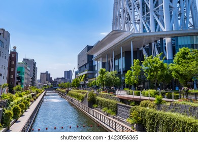 """SUMIDA, TOKYO / JAPAN - MAY 23 2019 : Landscape of """"Oshinari Park"""". It is a park made along the river by """"TOKYO SKYTREE"""". You can walk along the river while watching the tower."""