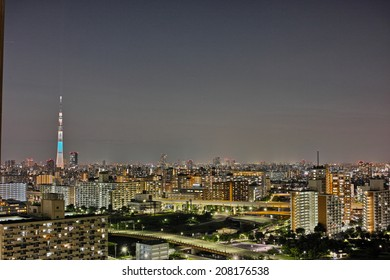 SUMIDA, TOKYO - JULY 28, 2014: Tokyo Skytree photographed at sunset from Edogawa Ward in Tokyo. Height: 634m, The tallest tower in the world. Anti seismic structure with latest technology.