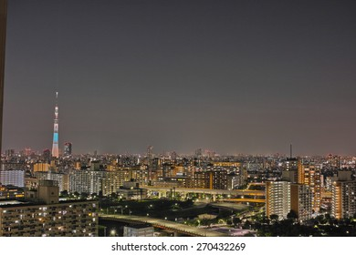 SUMIDA, TOKYO - JULY 28, 2014: Tokyo Skytree photographed at night, from Edogawa Ward in Tokyo. Height: 634m, The tallest tower in the world. Anti seismic structure with latest technology.