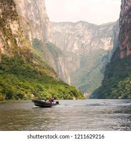 SUMIDERO CANYON, MEXICO - DECEMBER 2, 2016: Unidentified tourists in tour boat travel through the Sumidero Canyon Chiapas, Mexico.