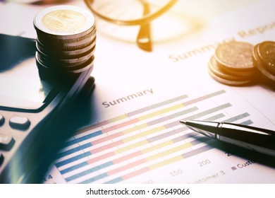 Summary report and business equipment on desk with finance saving concept.
