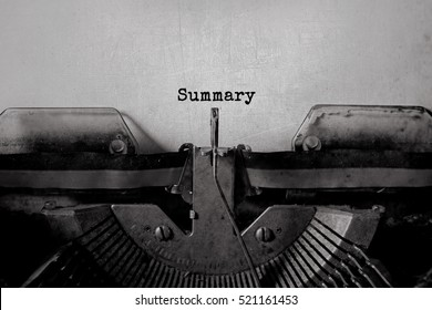 Summary typed words on a vintage typewriter
