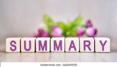 SUMMARY word written on wood cubes. Floral background