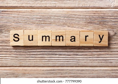 Summary word written on wood block. Summary text on table, concept.