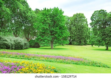 Summe rpark with lawn and flower garden