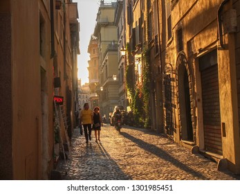 Summer 2016, people walkin through a street of Rome.
