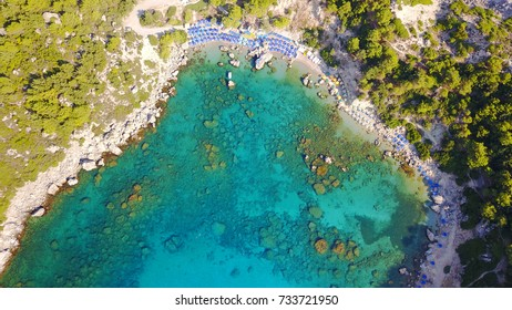 Summer 2017: Aerial bird's eye view photo taken by drone of famous beach of Anthony Quinn with clear water rocky seascape, Rhodes island, Greece