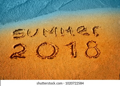 Summer 2018 nand drawn letters on beach sand. Text lettering design card template. Creative typography for Holiday Greeting Gift Poster. Calligraphy font style Banner.