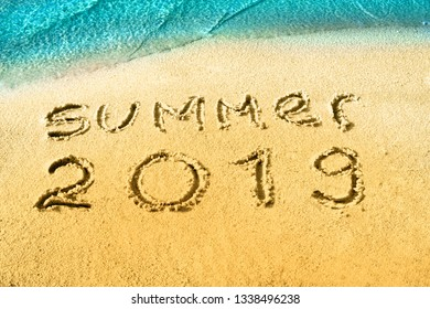 Summer 2018 nand drawn letters on yellow sand with blue sea paradise beach. Creative typography for Holiday Greeting Gift Poster