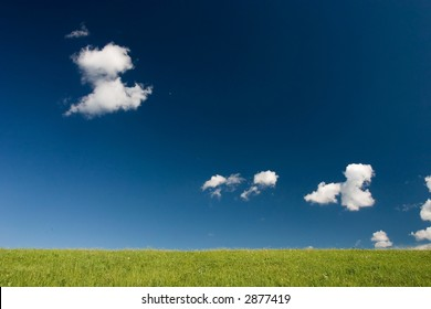 Summer abstract landscape with small white clouds