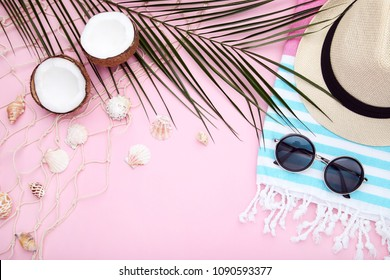 Summer accessories with coconuts on pink background