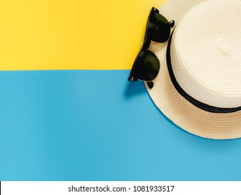 summer accessories and minimal flat lay concept from vintage hat and sunglasses decorate on pastel and colorful background