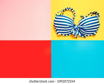 summer accessories and minimal flat lay concept from bikini, cloth decorate on pastel and colorful background