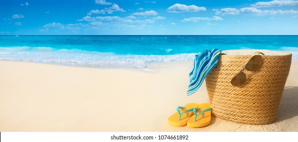 Summer accessories on sandy beach,Summer exotic relaxation concept.