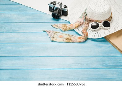 Summer accessories, vacation, travel, holiday top view background. Female accessories assortment. Womans hat and frame composition. Summertime and tourism concept