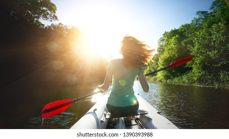 summer and active sport. a girl kayaking in sunset time