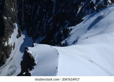 Summer adventure on the Mont Blanc massif , White Valley of Aiguille du Midi , French Alps, Chamonix, Haute Savoie region, France