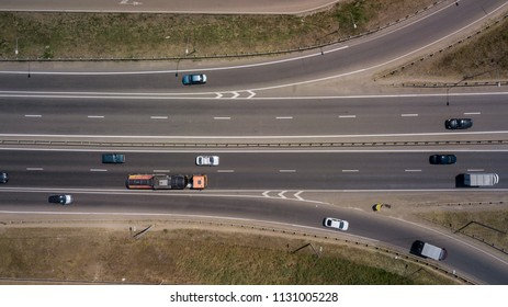 Summer aerial photo of transport junction, traffic cross road junction day view from above with circle road. Top down view of traffic jam.