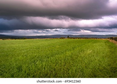Summer afternoon on countryside, Clouds over a farms and hills in Lancashire, England UK