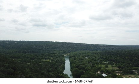 Summer afternoon overhead shot of the Guadalupe River in New Braunfels Texas.