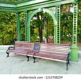 Summer arbor in park arbor benches.