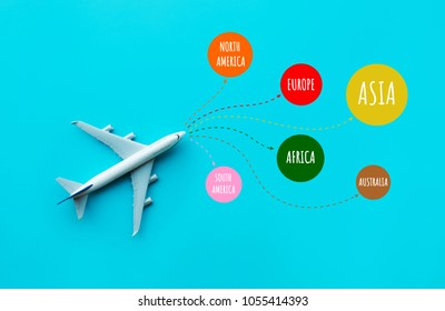 Summer and around the world concept with model plane,airplane on blue pastel color background.