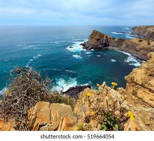 Summer Atlantic ocean rocky coastline scenery (near Arrifana Beach, Aljezur, Algarve, Portugal).