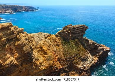 Summer Atlantic rocky coast view, Aljezur, Algarve west, Costa Vicentina, Portugal.