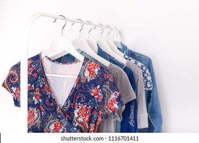 Summer, autumn, spring clothes hanging on a rack, trending concept