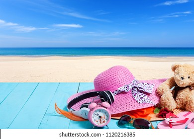 Summer background of beach hat and accessories for holiday time on wooden plank copy space for your text in summer and travel background
