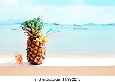 Summer background with cocktails pineapple against sea