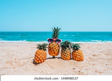 Summer background concept with pineapples at sea beach, Spring lifestyle design with copy space.