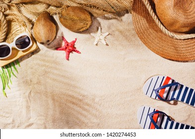 Summer background with copy space. Top view of sandy beach with visible sand texture and exotic accessories. Backdrop for products and mockup.