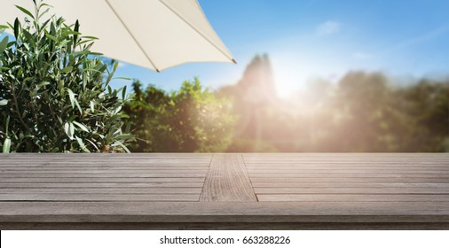 Summer background with empty wooden table for a concept