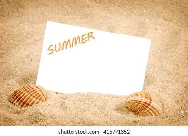 Summer background. Holiday season. Marine life. Card with sand and shells, copy space. Time for holiday. Frame.