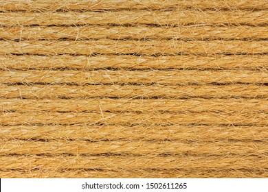 Summer background made of natural material. Mat made of ropes. Sisal.