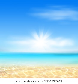 Summer background, nature of tropical golden beach with blue sky and white clouds. Golden sand beach with glare in water and defocused landscape. Copy space, summer vacation concept.