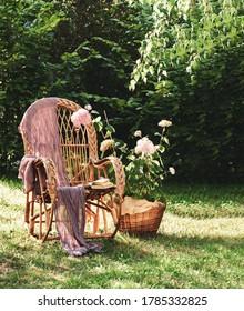 Summer background screensavers. Book on a wicker chair. Shady garden