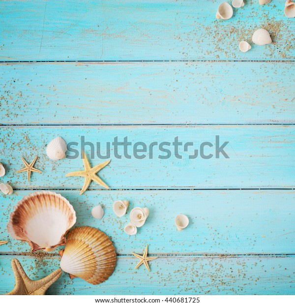 summer background. seashells border on wooden board