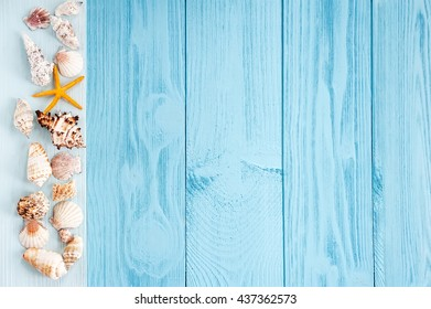 summer background. seashells on blue wooden background.