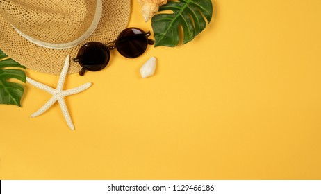 Summer background with straw hat and sunglasses. View from above. Flat lay