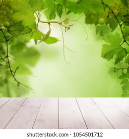 Summer Background with White Empty Wooden Board and Green Grape Leaves and Berries