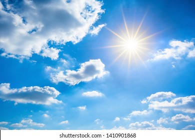 Summer background, wonderful blue sky with bright sun and clouds