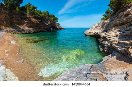 Summer Baia della Pergola small calm quiet beach, Gargano peninsula in Puglia, Italy.